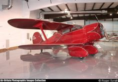 Staggerwing Beech D17R.  If an airplane can be called cute, this is it.
