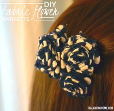 DIY Fabric Flower Hair Clip tutorial using fabric scraps, a glue gun and an old barrette. Perfect idea for the holidays.