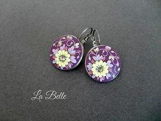 Purple earrings in the technique of flower filigree.