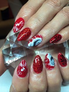 More wonderful work from Amanda Trivett using #CNDshellac Wildfire with #lecente #holographic deep red #glitter with handpainted work & stamping for a valentines day theme smile emoticon #lovelecente