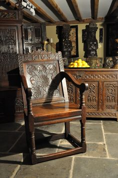 AN EXQUISITELY CARVED MID 17TH CENTURY ENGLISH DATED 1657 OAK WAINSCOT ARMCHAIR…