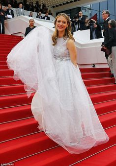 Heading up:Actress Heike Makatsch navigated her way up the stars in her floaty gown...