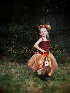 Sassy little scarecrow! This is an adorable costume for any little girl.    Costume is made with a brown lace romper, and comes with an OTT tutu