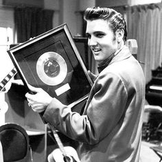 """Elvis Presley released """"Heartbreak Hotel"""" 61 years ago today. The song went on to become Presley's breakout single, having a colossal impact on both his career and on rock & roll history. """"That weekend, my mum came home with 'Heartbreak Hotel' and that changed my life. ... Elvis Presley changed everyone's life. I mean, there would be no Beatles, there would be no Hendrix. There would be no Dylan,"""" Elton John said of the King of Rock and Roll. Photograph by Don Cravens"""