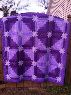 purple quilt.  hand quilted