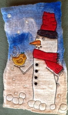 I love making snowmen from felt.....and my little bird appears again