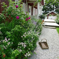 Love Mia's gravel path and garden border, well her house and whole garden too of course! from Mias Landliv blog in Norway