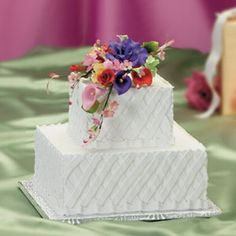 Another unique yet elegant two-tiered square wedding cake.
