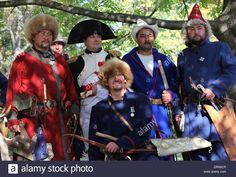 Download this stock image: Bashkirs who travelled to a reenactment of the Battle of Leipzig 1813. In their midst: an actor representing Napoleon Bonaparte. - dr52cr from Alamy's library of millions of high resolution stock photos, illustrations and vectors.