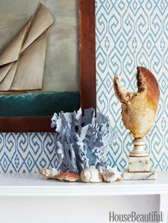 Mantel details: Blue coral, a 19th-century lobster claw, and a vintage American marine relief painting. Design: John Knott and John Fondas.