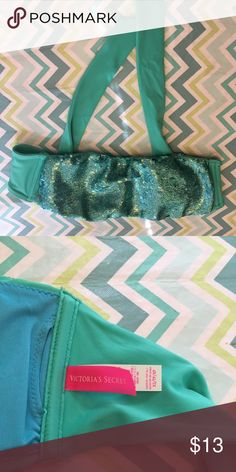 Size XS Bandeau Victoria's Secret Bikini Top Cute size XS Victoria's Secret bandeau style bikini top, turquoise with sequins, great condition and gently used. PINK Victoria's Secret Swim