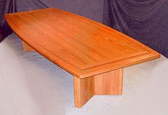 cherry wood conference table with a black walnut border inlay, custom made for a art gallery. Neal Burns 509-466-4684