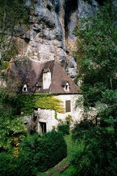 A house along the River Célé built into the side of a cliff, near Sauliac-sur-Célé, Midi-Pyrénées, France