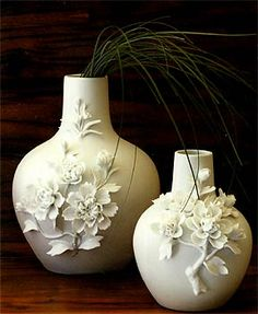 could make these vases-- glue flowers and then spray paint- porcelain flowers