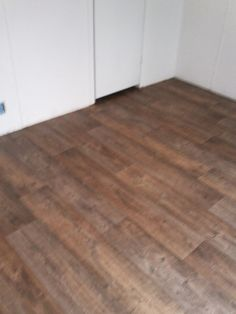 Dana's mobile home. I love this flooring. I had this laid from one end of the mobile home to the other. It's vinyl. So easy to take care of and you can't see the dirt. Can buy at Home Depo.