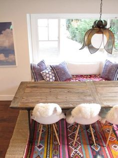 This kind of looks like a ready made pinterest dining room,... look: I have that chandelier pinned as a seperate item i`d like,.... that table as a DIY project ( made from an old door tyvm :)  .. shag for decoration .... my work is done :P
