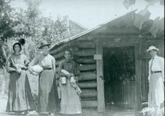 LOG CABIN PHARMACY, 1910      Introducing modern medicines to the backwoods of North Carolina and coaxing residents away from their homemade remedies were no easy tasks, especially for a woman in the early 1900s. Shown here is one of the first pharmacies in Henderson County. Located between Edneyville and Bat Cave, it was operated by Dorothy Sharpe, who is standing at the right in the adjacent photograph.      NCC Photo Archives