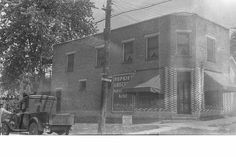 Hopkins Grocery, 301 Spruce, shortly after it began operation in Spring showing the infamous mis-spelled Trout's Bakery sign. Note also the 1929 Dodge half-ton 'Merchant's Express' pickup, purchased for the store in February (photographer unknown) Boonville Missouri, Bakery Sign, Historical Images, Trout, Old Photos, Dodge, February, Cool Stuff, History