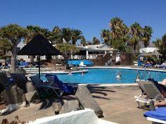 Las Casitas swimming pool and sun loungers.