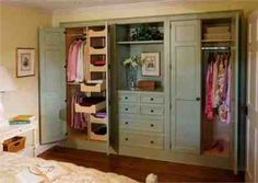 Built in cedar closet with pine doors for contrast? Match doors to cornice above window to tie it all together...