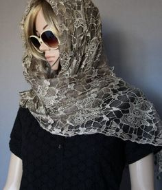 This beautiful polyester lace tassel scarf comes in two colours, black or light brown. A very fashionable scarf, very soft and smooth on the skin. A beautiful scarf to have in your collection.