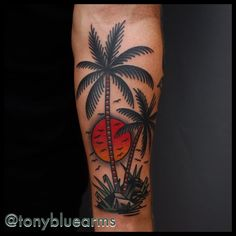 Traditional Sun And Palm Tree Tattoo
