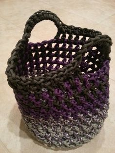Paracord bag with handles. PATTERN: mostly double crochet, ch1 repeating. Paracord: nylon paracord makes a flexible, yet durable bag