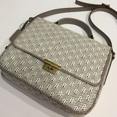 BOGO Sale!! New Fossil Satchel White and black detail with light gray border and bronzed/gold hardware. Short handle or adjustable satchel strap (not removable). Style is Memoir Straw Flap, Light Grey. Feel free to ask any questions or make an offer! Fossil Bags Satchels