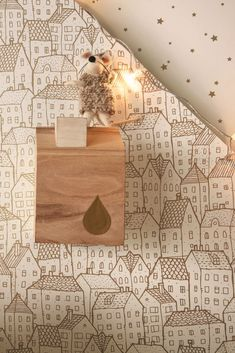 A sweet illustration of higgledy rows of houses, shown in this wallpaper design from the new Caselio Pretty Lili wallpaper design.