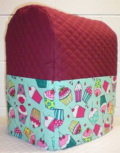 Check out this item in my Etsy shop https://www.etsy.com/listing/218429637/burgundy-teal-quilted-cupcake-cover-for