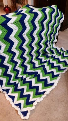 Queen sized, chevron striped, Seattle Seahawks colors crochet blanket crochet by me.  Queen sized, chevron striped, Seattle Seahawks colors crochet blanket crochet by me.  Https://www.pinterest.com/maggieg2872/maggies15fiestas-made-by-me/         https://m.facebook.com/Maggies15Fiestas