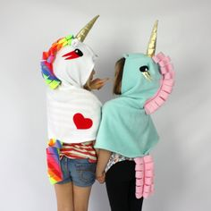 Our Unicorn Cape is the perfect outfit for riding on rainbows, dancing in the clouds and midnight trips to the moon! The hooded cape is made from soft polar fle Unicorn Halloween Costume, Unicorn Costume For Kids, Fleece Crafts, Diy Crafts, Rainbow Costumes, Diy Cape, Fleece Poncho, Pink Costume, Unicorn Hoodie