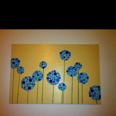 "Another project complete! Thank you pinterest! I traced the large circles that make the flowers before painting with the blue- I used cups and bowls. Then used these ""circle brushes"" I found at Michaels (look down the the stenciling aisle) to finish I just stamped the circles with the different shades of blue"