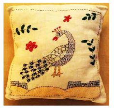 Beautify your Home with this kantha embroidery stitch small scented cushion, it gives new and exceptional look to your decor. This cushion is decorated with a beautiful peacock looking at it's tale. Perfect gift that add lively colors to your decor. The base color is whiteHandmade, Indian Luxury embroidered furnishings for Living Room, Dining Room, Bedrooms, Plagrooms and Study rooms or formal table linen in silk, cotton, jute, velvet or organdy  for Corporate Dining, all is now available...