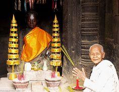 Praying nun, Angkor Wat Praying in Angkor Wat, Cambodia.