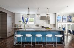 A bold blue island takes center stage in a sleek and modern kitchen designed by Meghan Browne of Jennifer Gilmer Kitchen & Bath Kitchen Design: Meghan Browne Contractor: Lappas Construction 📷: Keith Miller Small Kitchen Redo, Kitchen And Bath Design, Modern Kitchen Design, Kitchen Cabinet Colors, Kitchen Cabinetry, Home Design Magazines, Kitchen Island With Seating, Kitchen Islands, Kitchen Trends