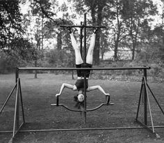 Forget traditional gymnastics! Ladies in the '30s strapped themselves up to this backyard apparatus to practice their backflips.