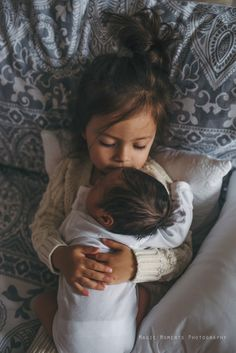 Sibling photography newborn holding baby love family ideas shots siblings brother sister babies photographer Alabama sweet baby