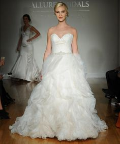 Allure fall 2016 wedding gown with modified sweetheart neckline, lace bodice with beaded belt and draped full ball gown | https://www.theknot.com/content/allure-wedding-dresses-bridal-fashion-week-fall-2016