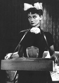 Audrey Hepburn as a cigarette girl in Laughter in Paradise (1951)