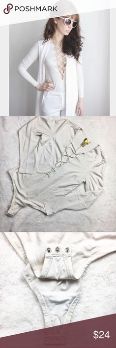 H&M off white long sleeve lace up bodysuit 10 nwot This bodysuit is in brand new condition and is just missing it's tags. It's the perfect fall bodysuit and match any and everything! It's an off white color. Approx measurements are: length 24 inches bust 34 inches H&M Tops