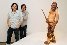 Dutch artist Adrie Kennis (L) and Alfons Kennis, the two artists who made the reconstruction of a mummy of an iceman named Otzi, discovered on 1991 displayed at the Archaeological Museum on February 28, 2011