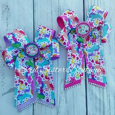 Bright and colorful unicorn 4 loop tails down hair bow. www.facebook.com/soulsisterboutique