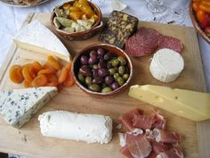Cheese Board idea-  but this is pretty lame,  but you get the idea- in lieu of all the app picks, i suggested just having a bomb cheese,olive, fruit, and crudite spread with dips.  i always prefer doing this so you can set it up, check on it during  the rest of your cook, and not feel overrun  by the appetizer section of the evening...