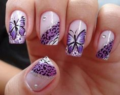 Beautiful butterflies nail art design in Periwinkle hue. Using a lighter shade of Periwinkle as base color, the nails also sport a leopard print French tip lined with silver sparkles and black and white curved lines. A moderate Periwinkle color is then used for the butterflies and black polish for the details.