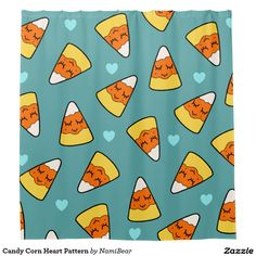 Candy Corn Heart Pattern Shower Curtain by NamiBear on Zazzle.com. This is a drawing of a candy corn with a smile on her face with hearts around her. It has a green background.