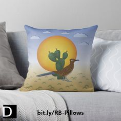 This colorful throw pillow features a greater roadrunner standing in front of a prickly pear cactus and a large, oppressive sun with sparse, rainless clouds overhead and spiny little plants dotting the landscape. https://www.redbubble.com/people/debidalio/works/12140864-soul-of-the-southwest?p=throw-pillow #homedecor #bedding #home #decor #StudioDalio Redbubble