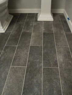 Wide plank tile for bathroom. Luv the grey