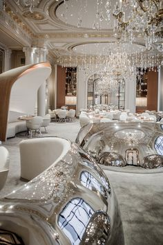 exploded chandelier - reflective banquette bubbles  Plaza Athénée By Jouin Manku