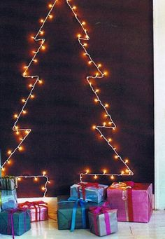 """We spotted this 2-D tree in Domino Magazine this month and thought it would be a great idea for those of us that don't have a ton of room for a real tree. They suggest to lightly pencil an outline on the wall and secure two tiny nails or tacks at each """"point"""" and run the cord around the edge."""
